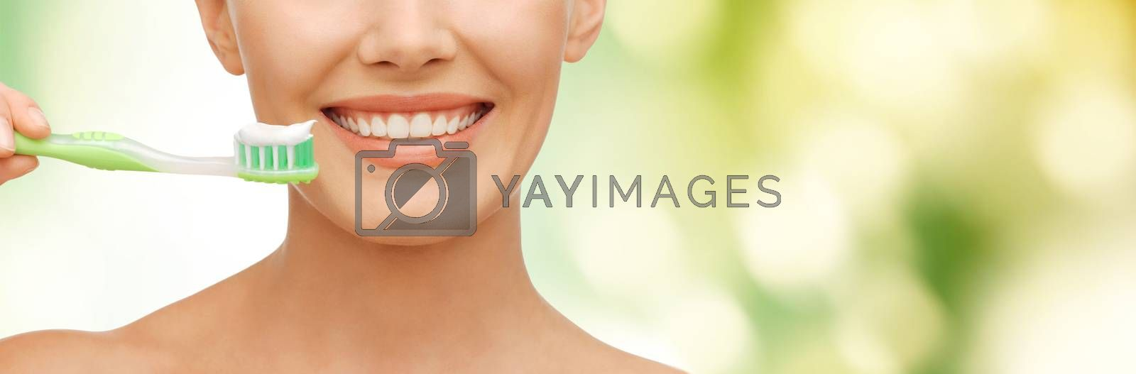 beautiful woman with toothbrush by dolgachov