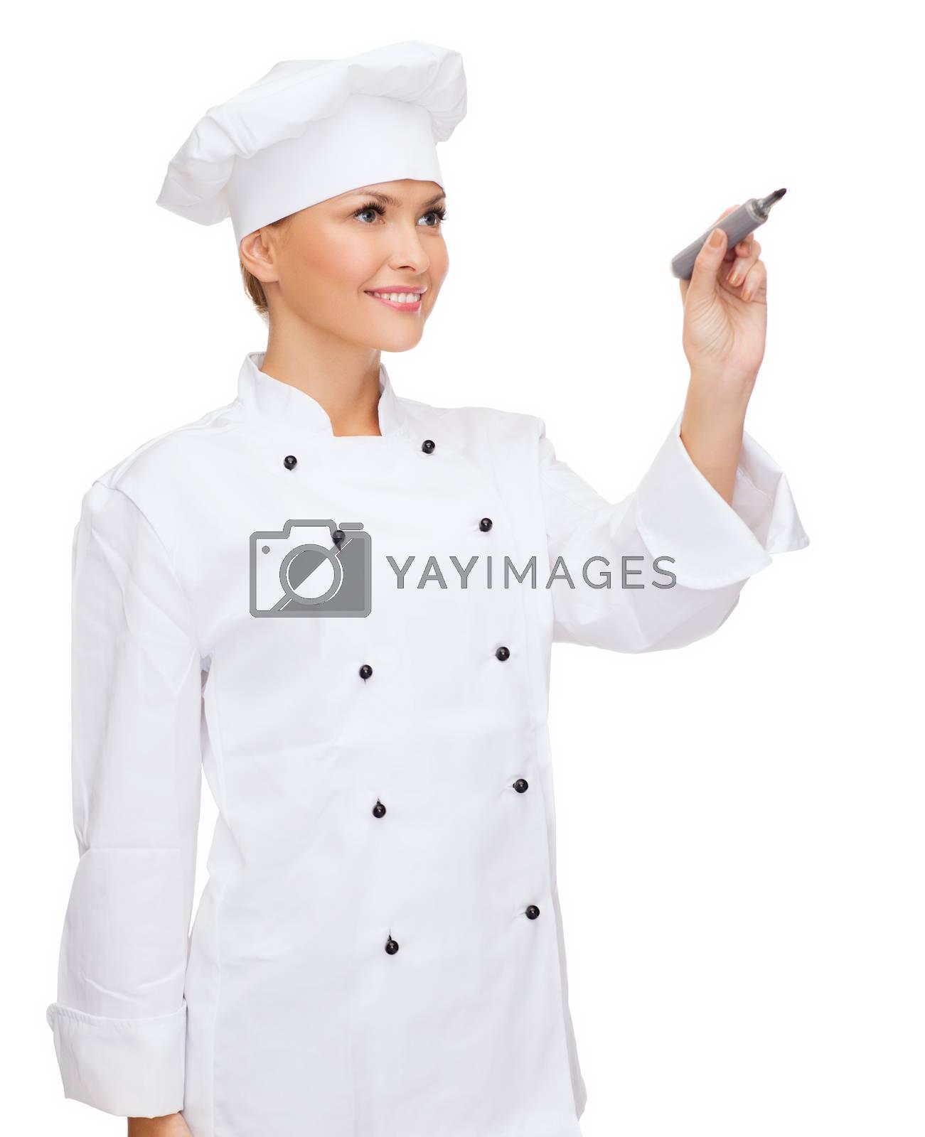 smiling female chef writing something on air by dolgachov