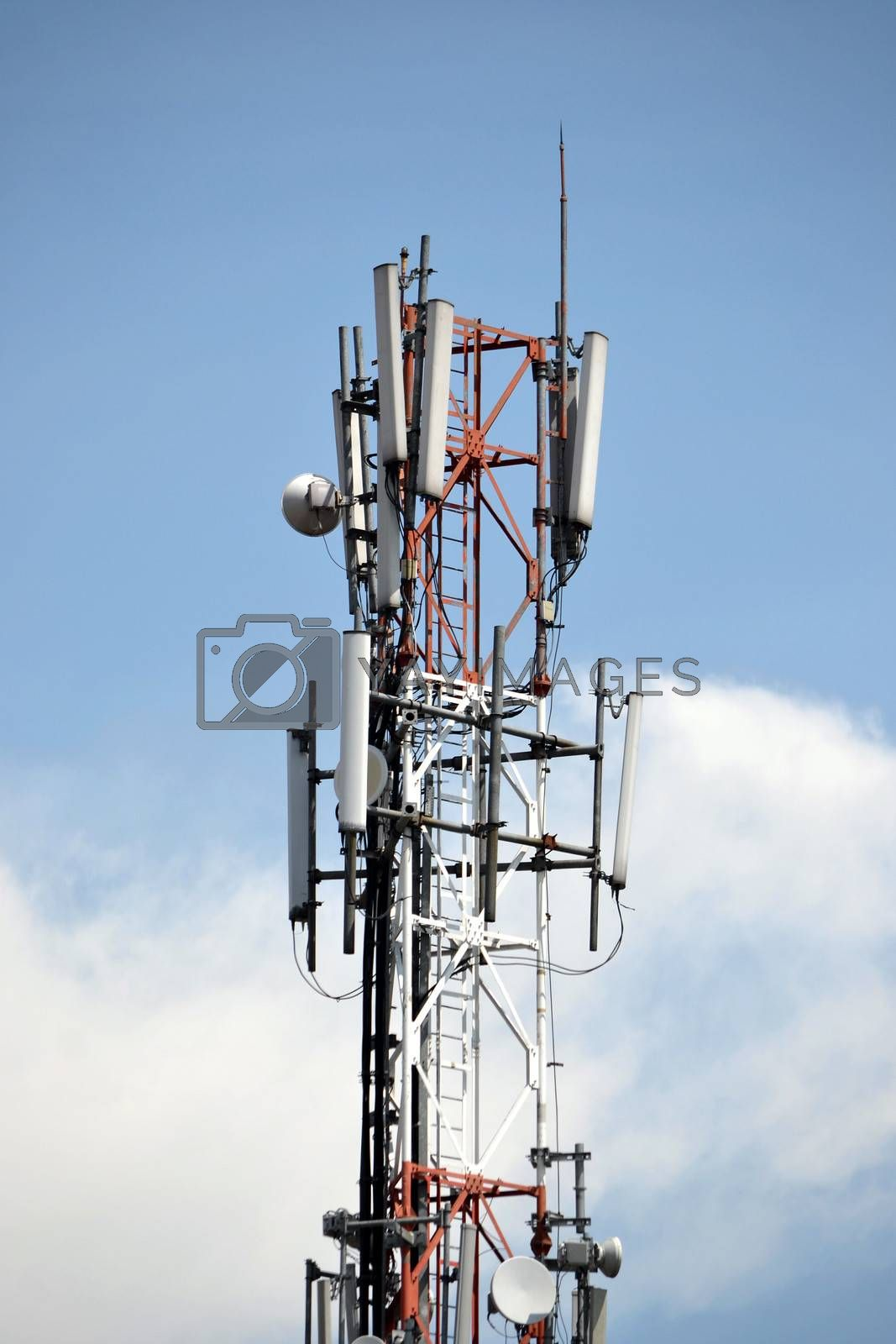 typical communication tower in telecommunication industry againts blue sky