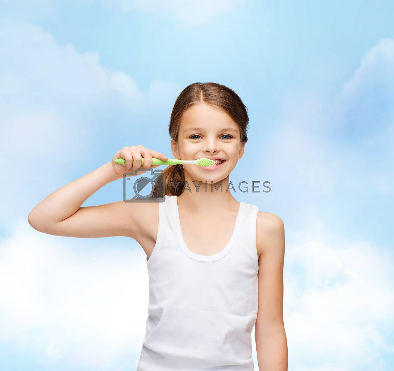 shirt design, health, oral hygiene, dental concept - smiling teenage girl in blank white shirt brushing her teeth