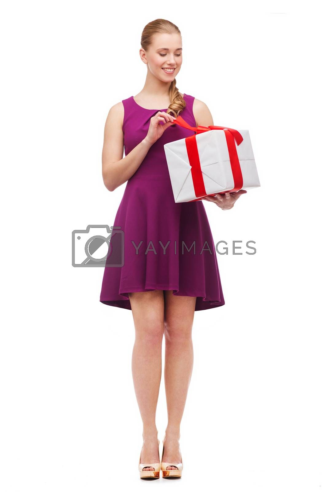 celebration and birthday concept - wondering smiling girl with present box