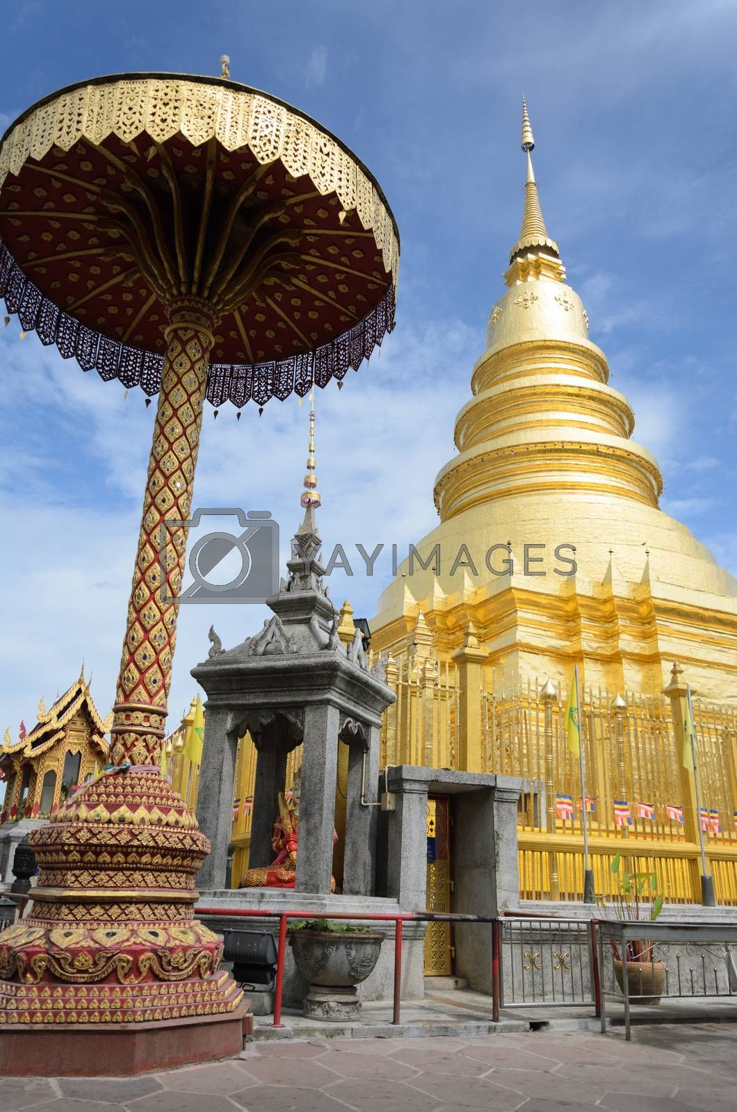 Royalty free image of Golden Pagoda at Wat Phra That Hariphunchai in Lamphun province by hatoriz