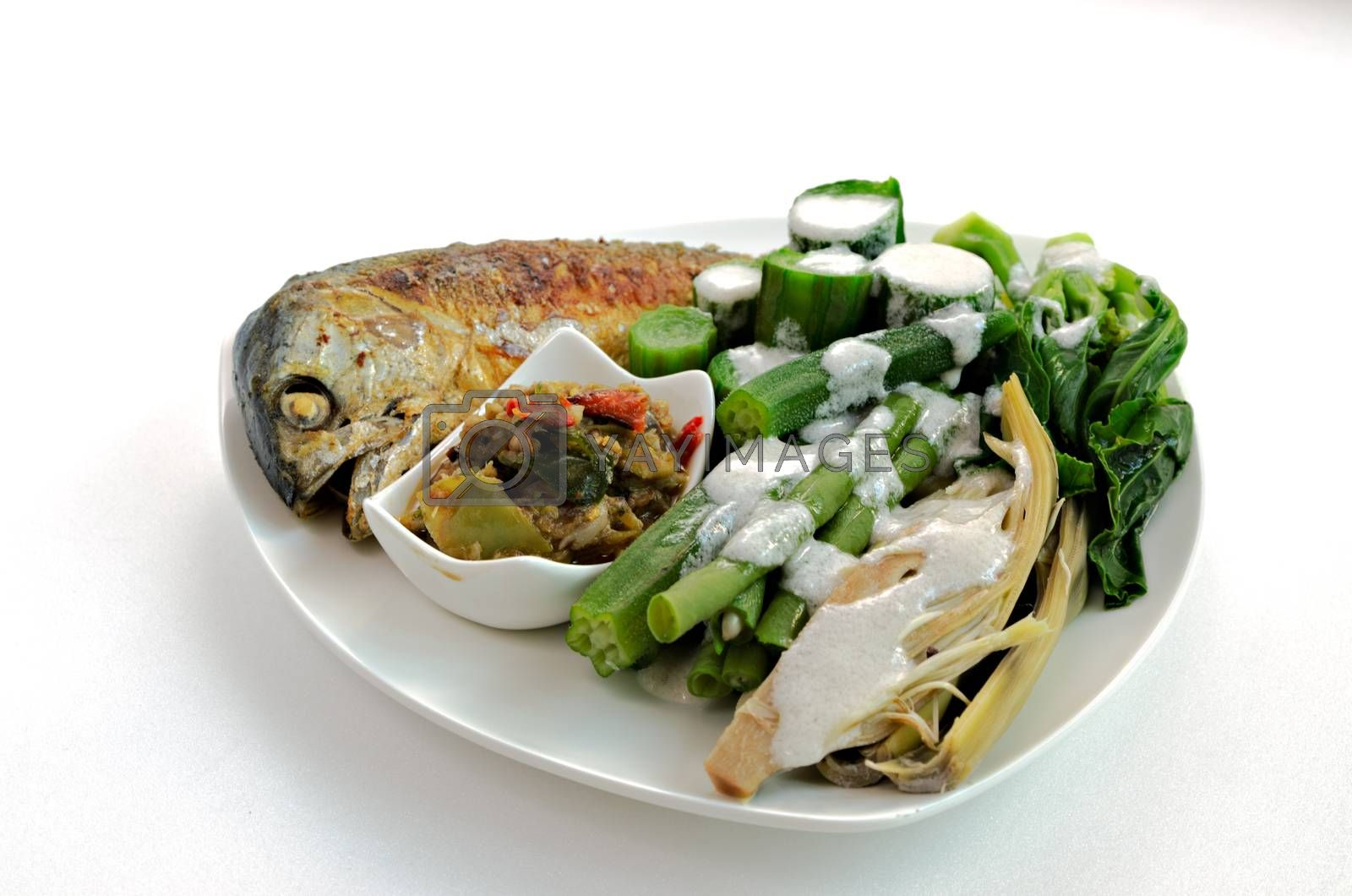 Royalty free image of Fired mackerel with chili paste and steam vegetable by hatoriz