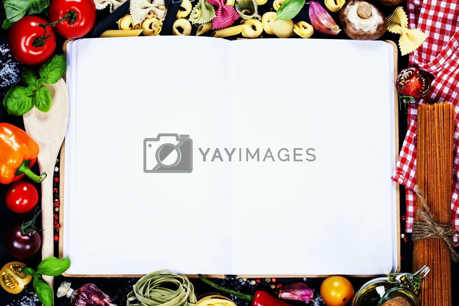 Royalty free image of  Open Notebook and Fresh Vegetables Background by klenova