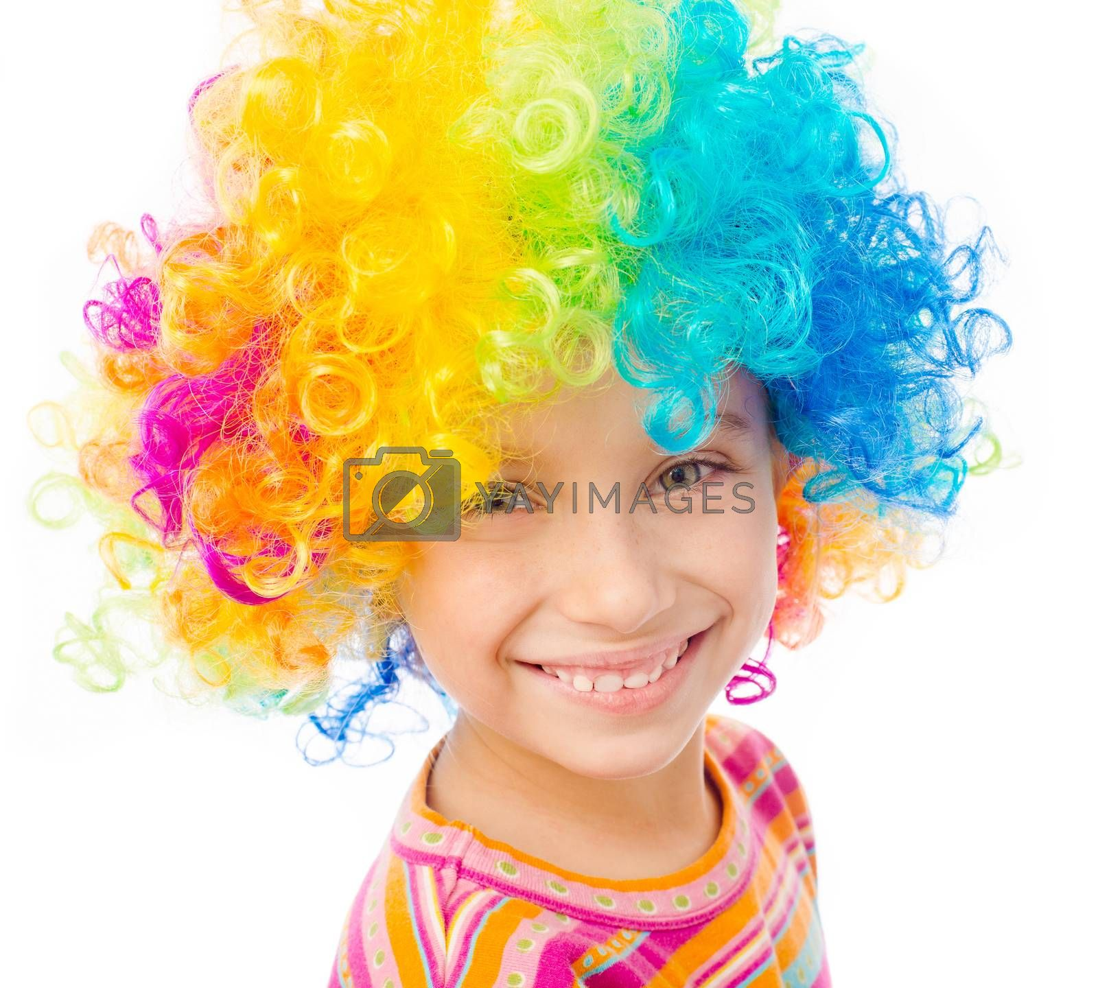 Royalty free image of little girl in clown wig by GekaSkr