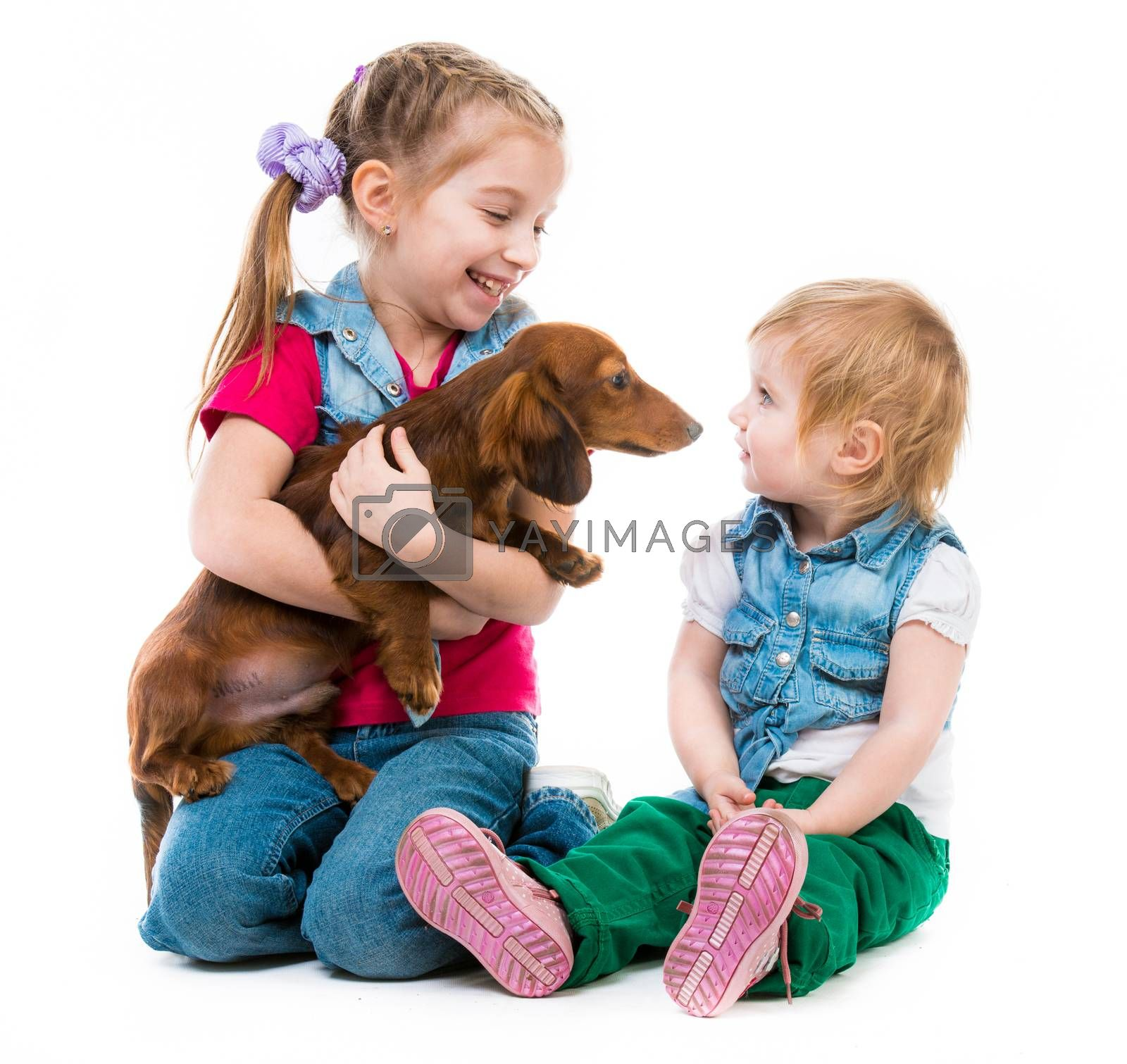 Royalty free image of kids with dachshund by GekaSkr