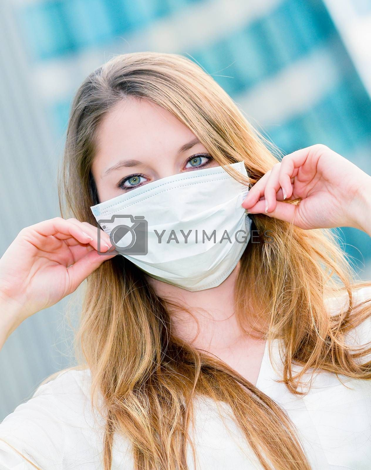 Royalty free image of Junior executives dynamics  wearing protective face mask against by pixinoo