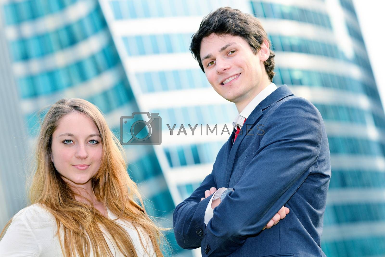 Royalty free image of expressive portrait Junior executives of company crossed arms by pixinoo