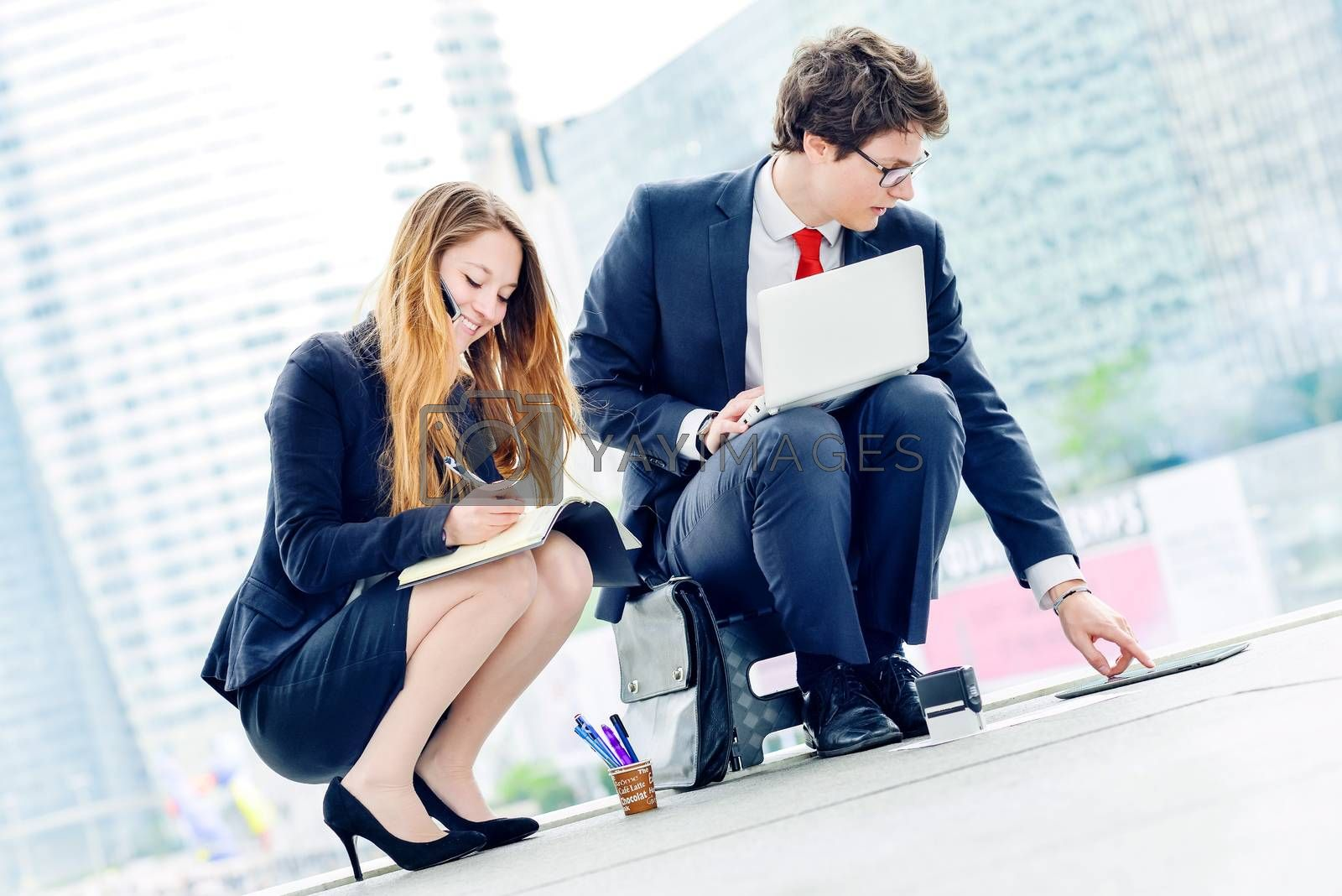 Royalty free image of Junior executives dynamics working outside of their office by pixinoo