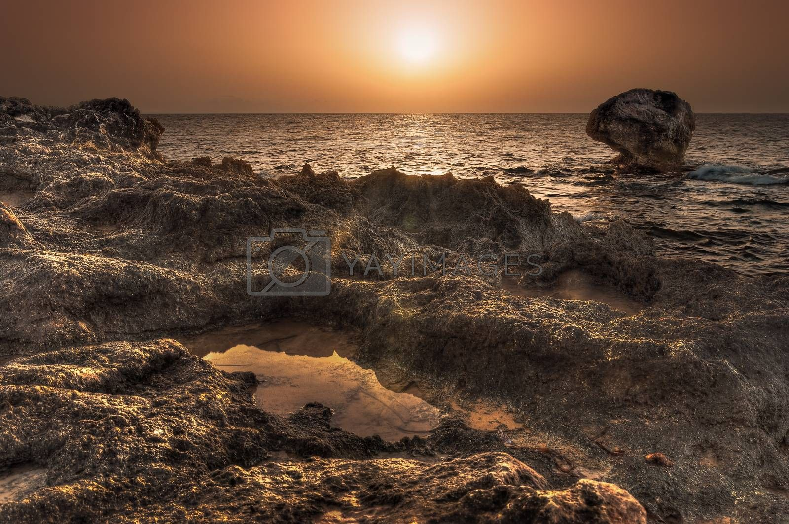 Royalty free image of sunset over the sea by Kayco