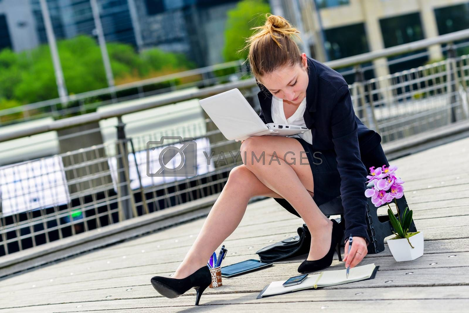 Royalty free image of Junior executive dynamic working outside of her office by pixinoo