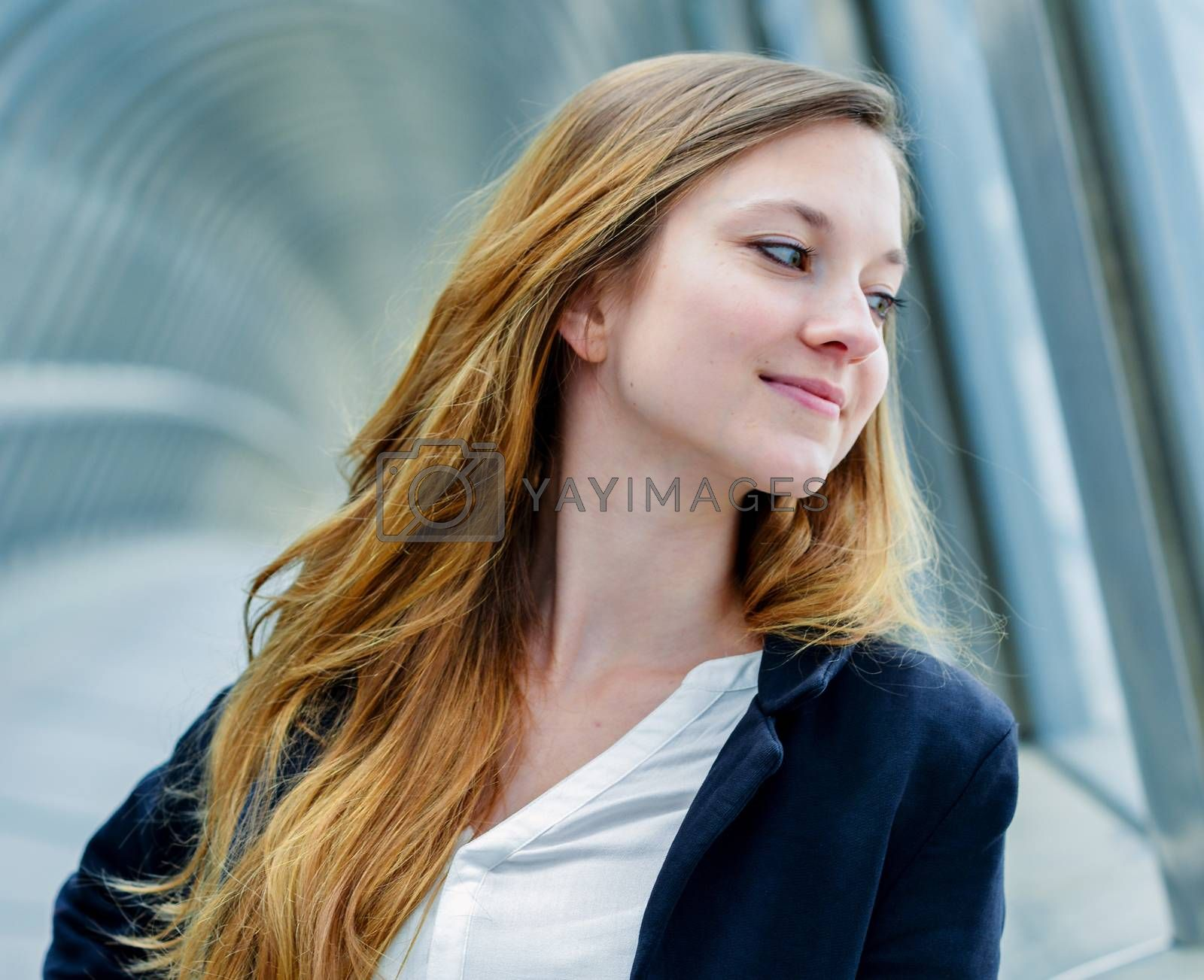 Royalty free image of Outdoor portrait of a pretty dynamic junior executive by pixinoo