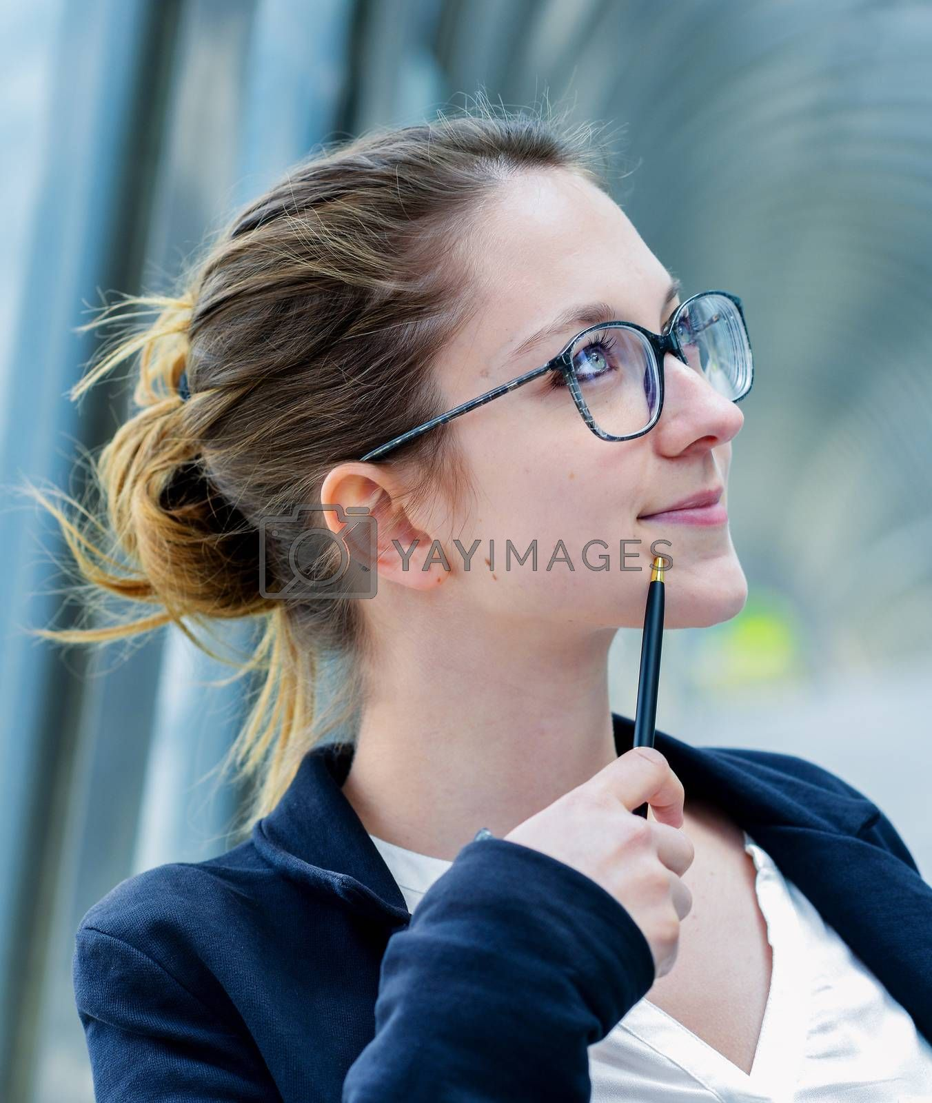 Royalty free image of Outdoor portrait of a dynamic junior executive thinking by pixinoo