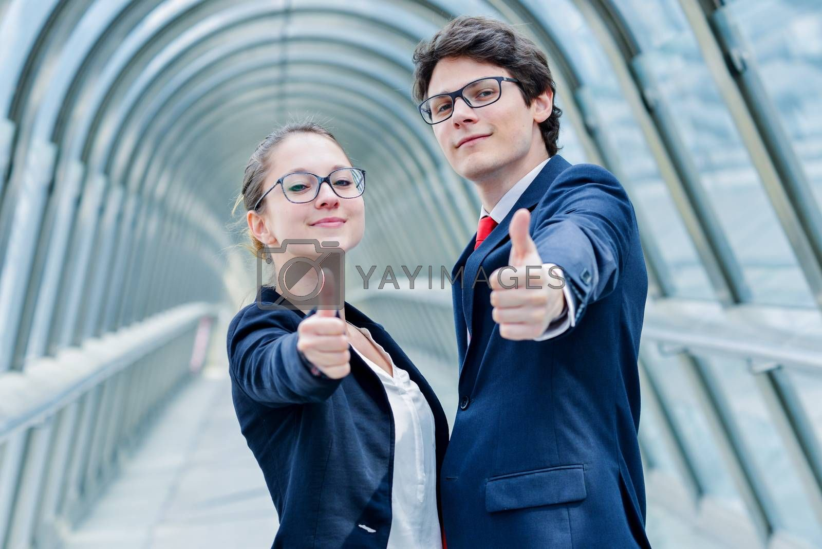 Royalty free image of expressive portrait of junior executives of company thumb up by pixinoo