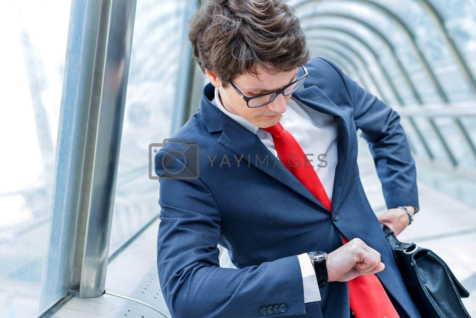 Royalty free image of Junior executives of company watching time by pixinoo