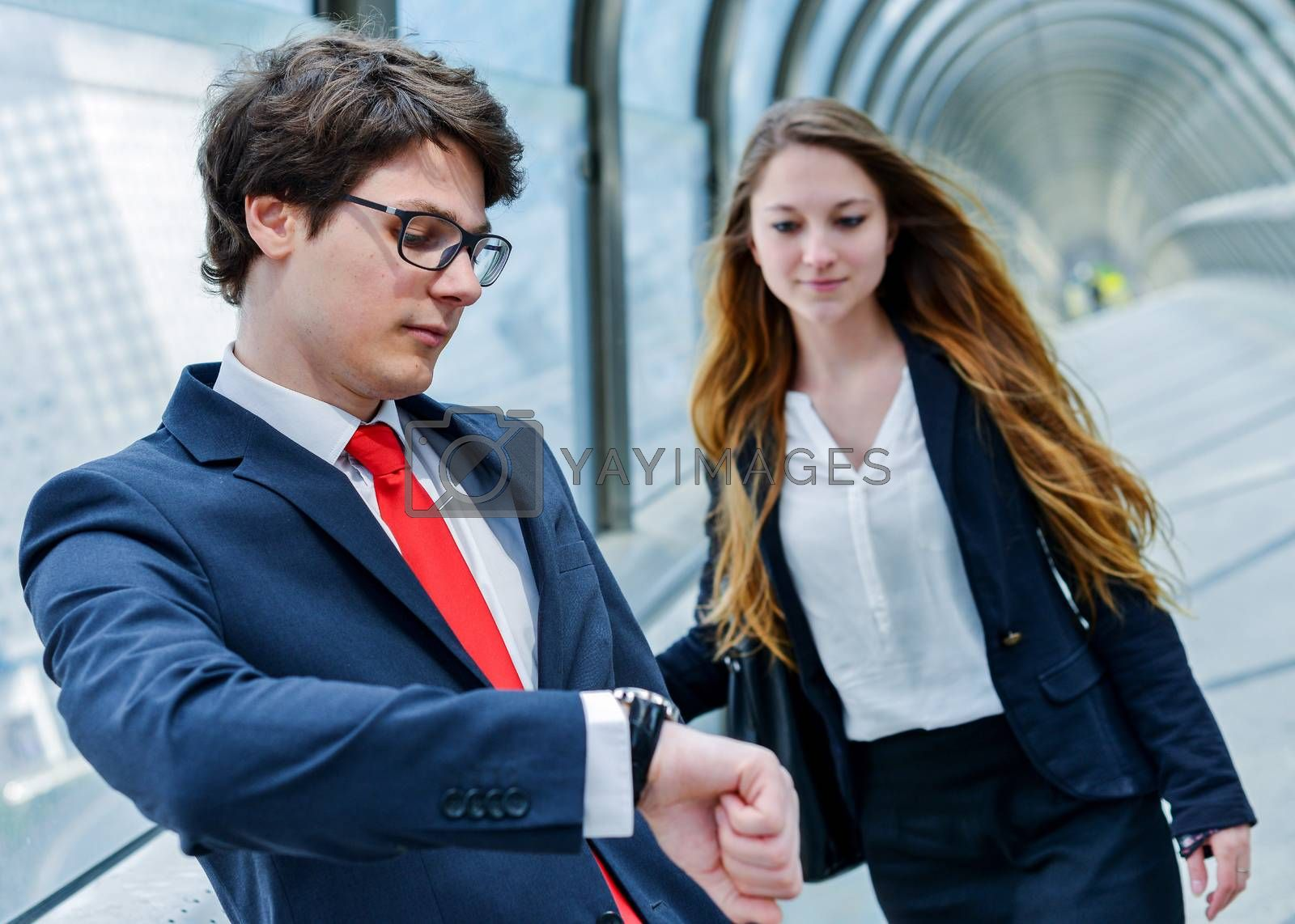 Royalty free image of Junior executives of company are late for a business meeting by pixinoo