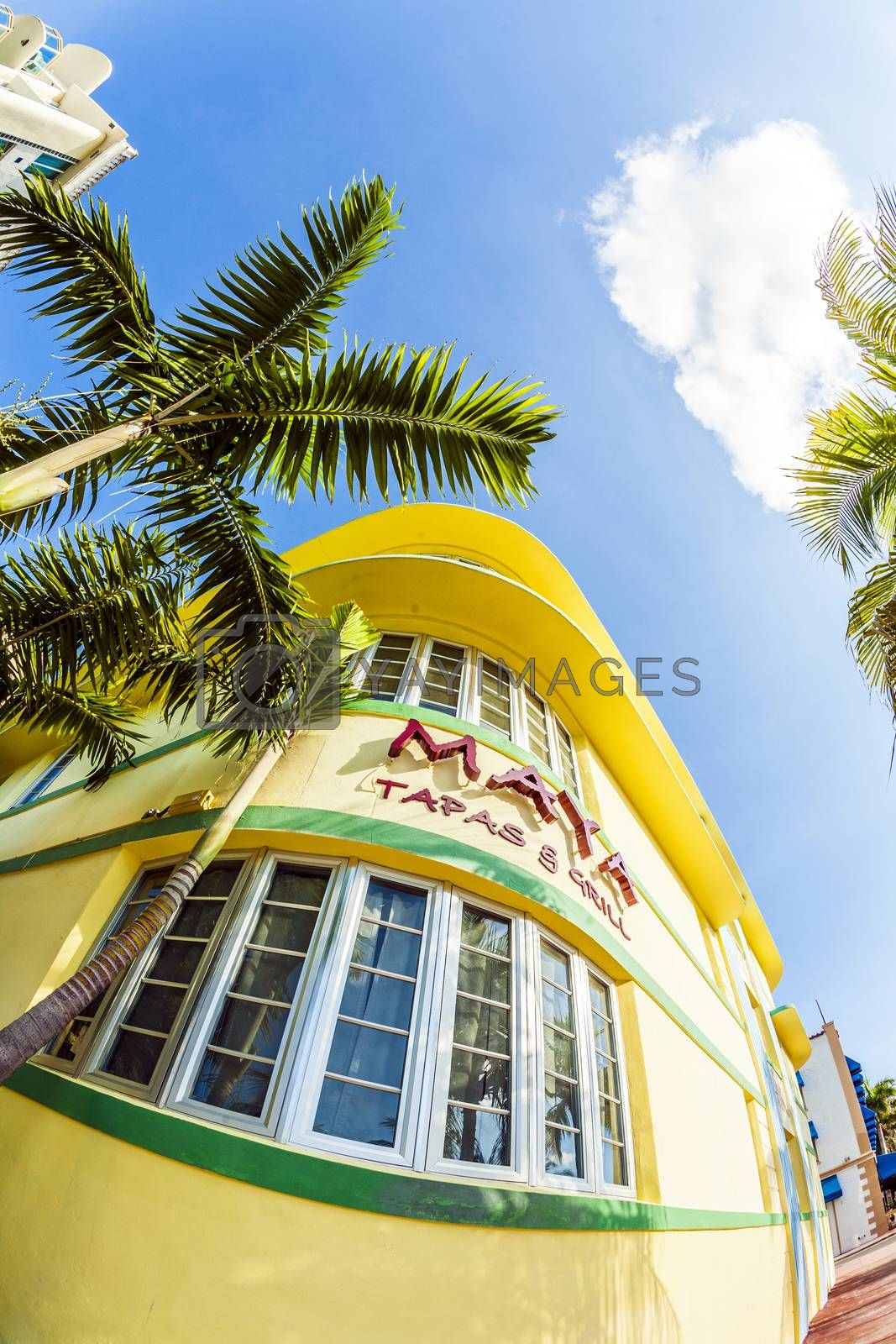 MIAMI, USA - JULY 31, 2010: facade of art deco building at Ocean drive with Maya Grill restaurantin Miami, USA. Art Deco architecture in South Beach is one of the main tourist attractions.