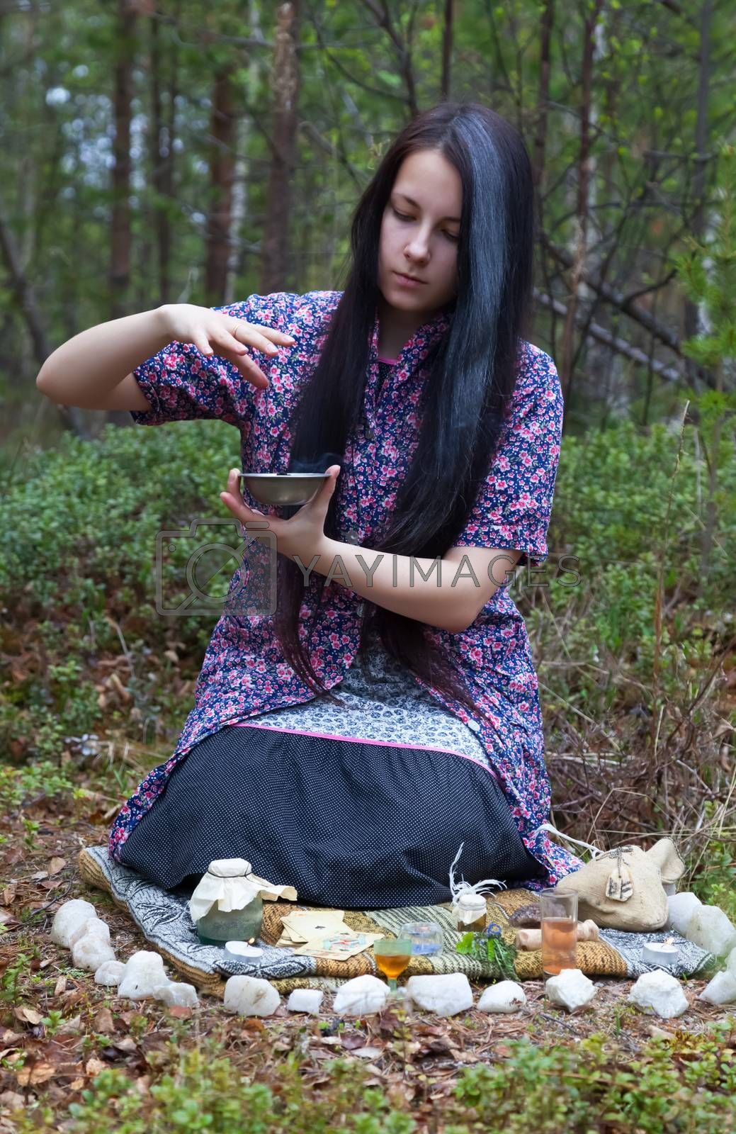 Royalty free image of Girl witch conjures in the woods  by AleksandrN