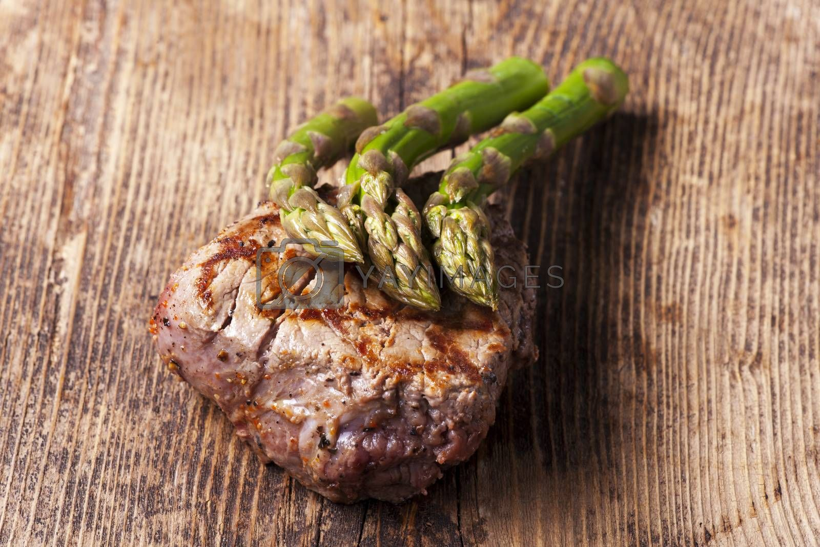 Royalty free image of juicy grilled steak with asparagus  by bernjuer