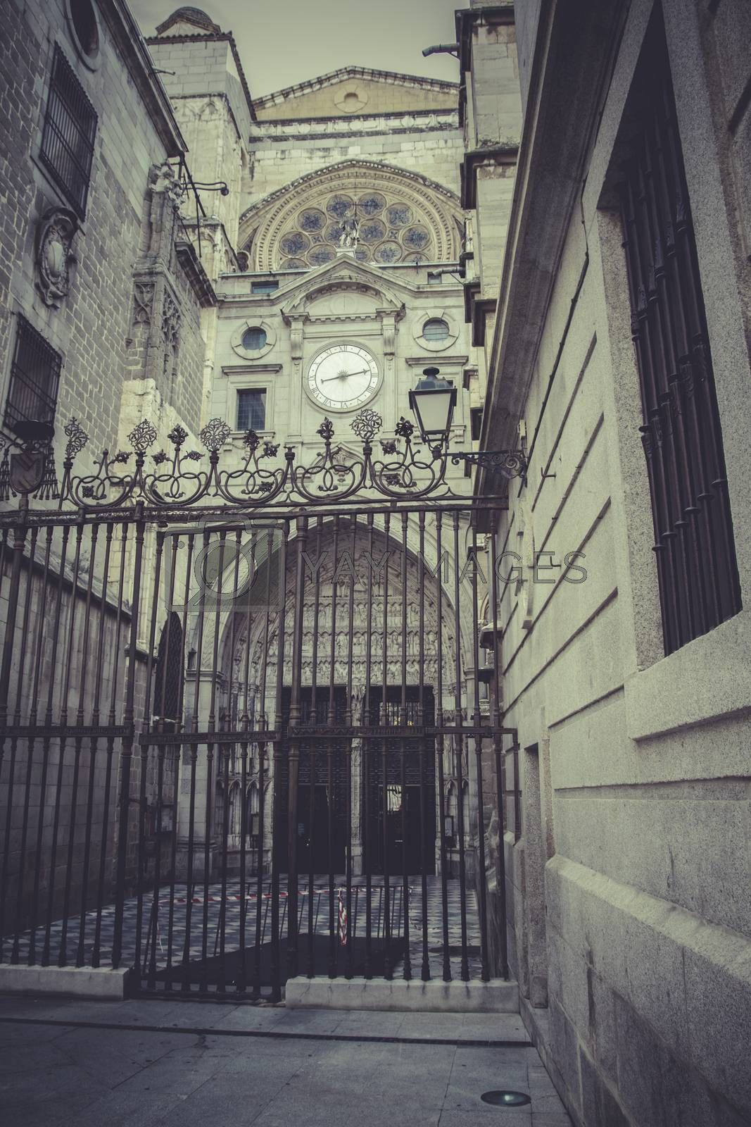 side entrance of the Cathedral of Toledo, arc with religious rel by FernandoCortes