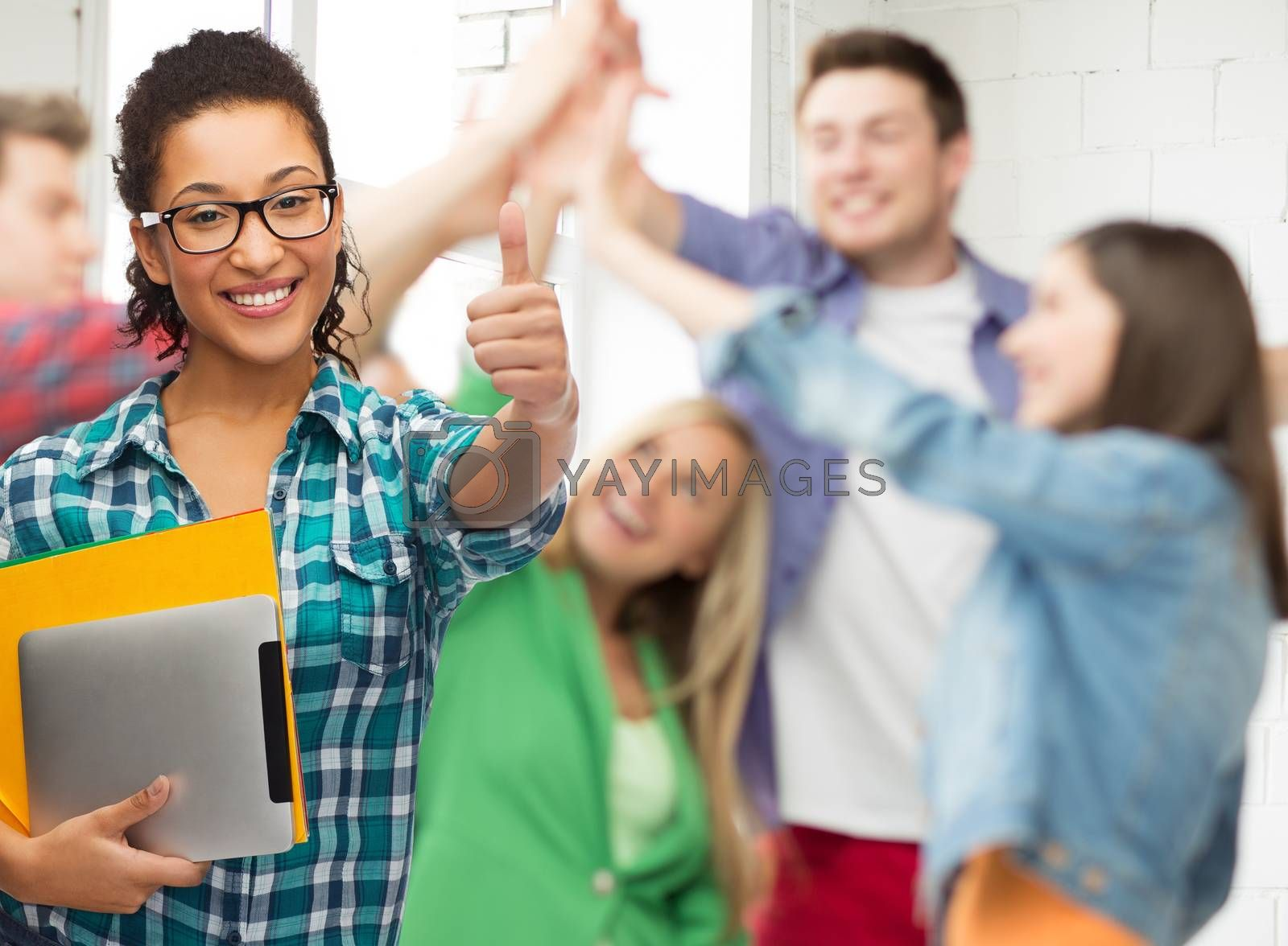 education, technology and people concept - smiling female african american student in eyeglasses with folders and tablet pc at school