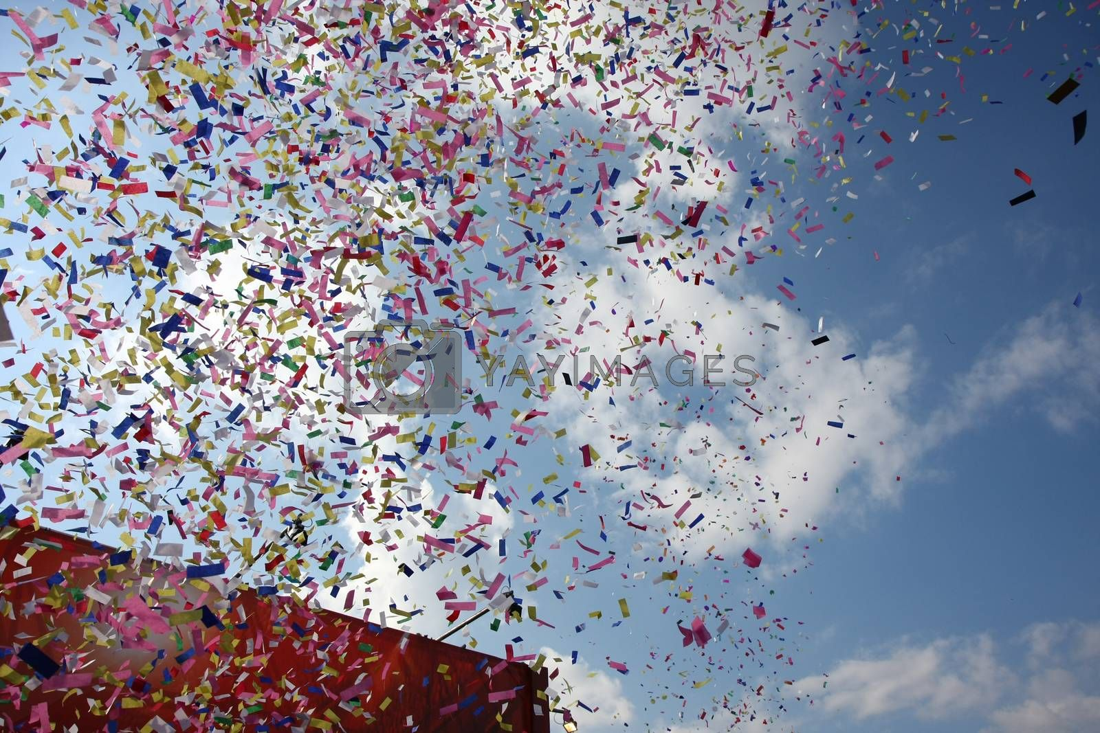 Celebration with Colorful confetti wiith blue sky in the background