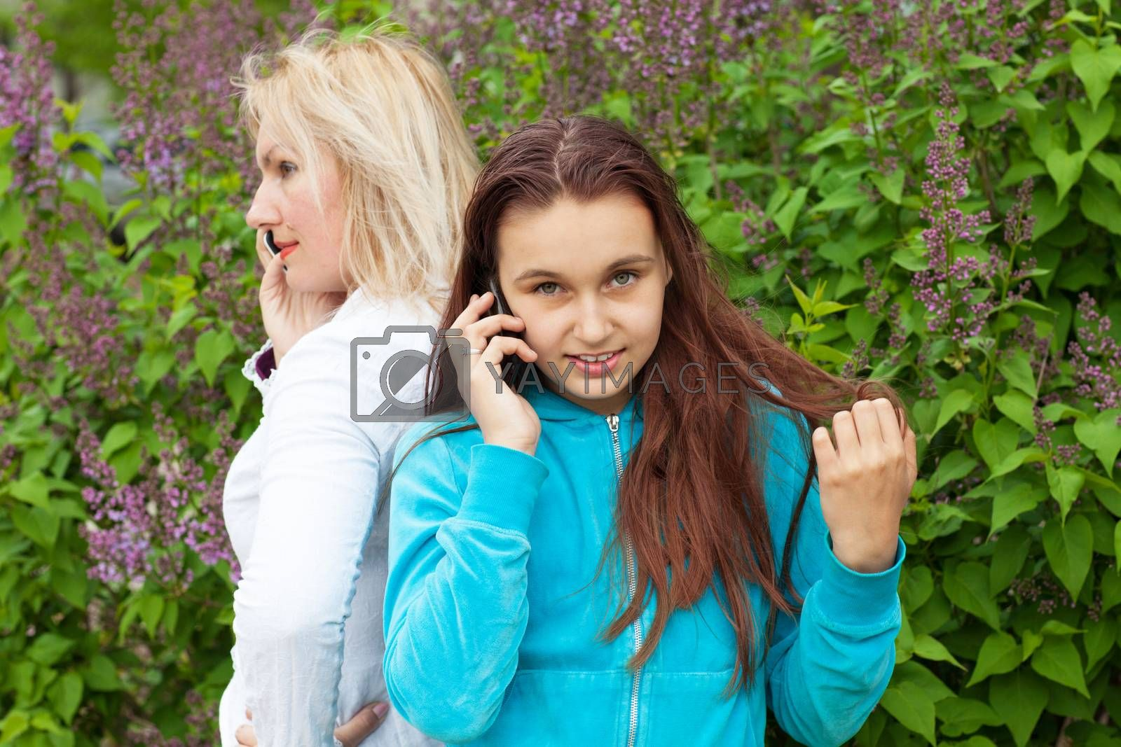 mother and daughter talking by phones