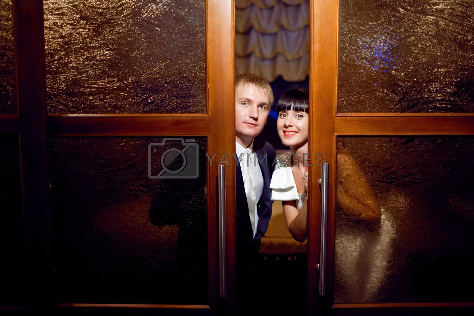 bride and groom near the door