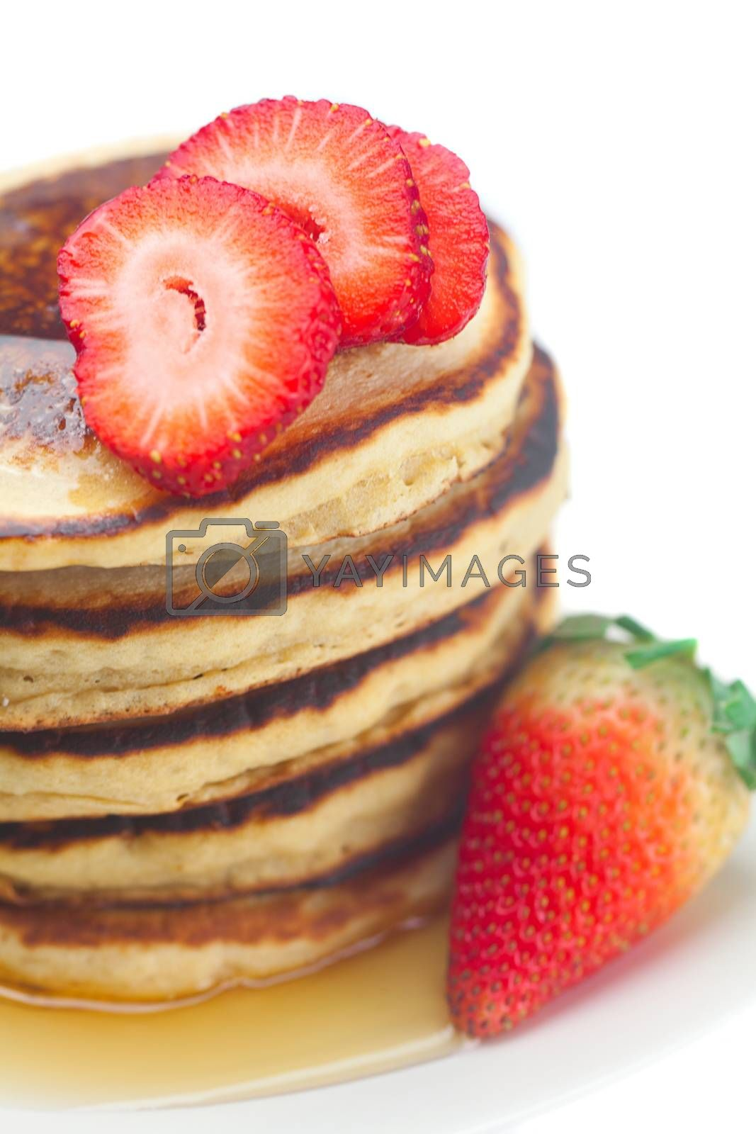 Pancakes, honey and strawberry isolated on white