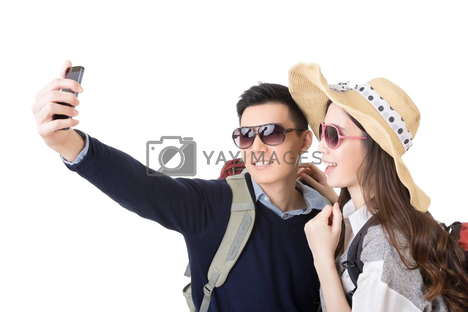 Asian couple travel and take a selfie on white background.