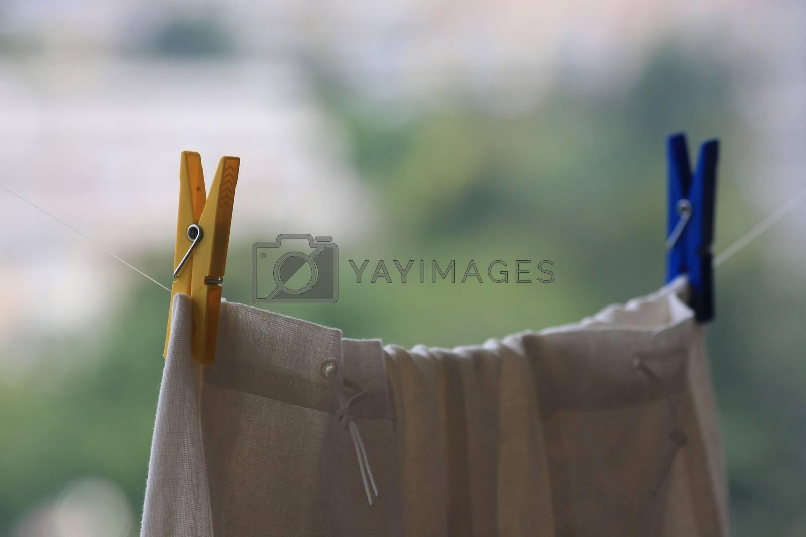 Plastic laundry clips holding skirt on the terrace
