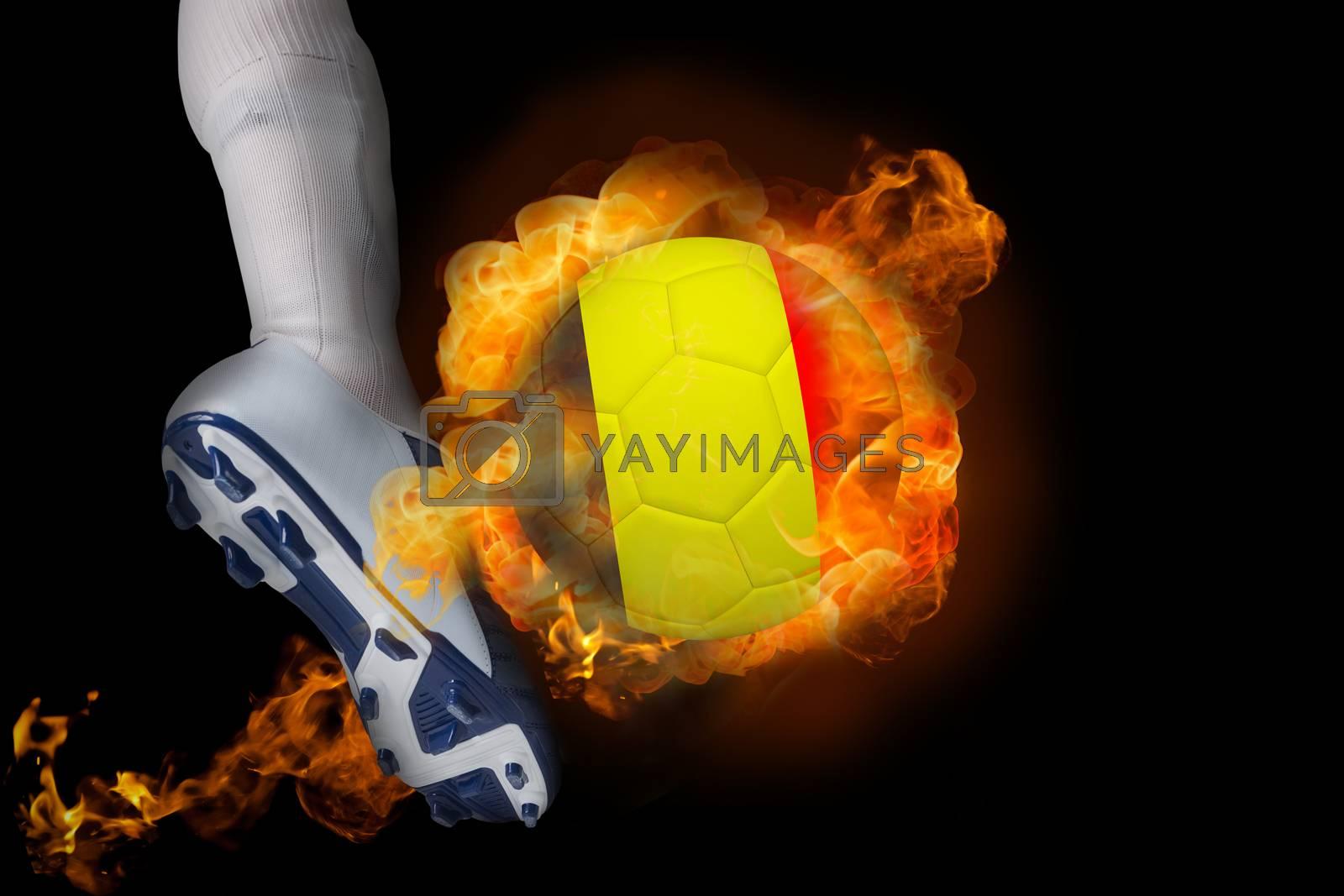 Football player kicking flaming belgium ball by Wavebreakmedia