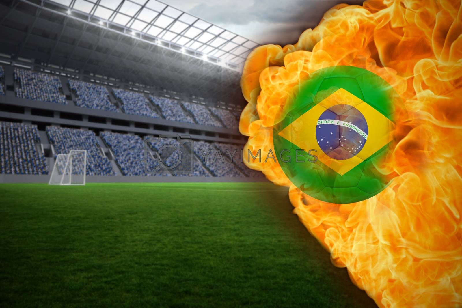 Fire surrounding brasil flag football by Wavebreakmedia