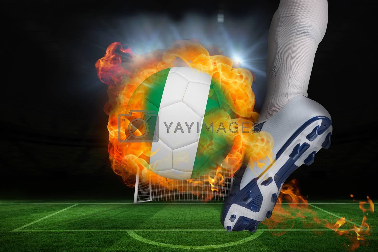 Football player kicking flaming nigeria flag ball by Wavebreakmedia