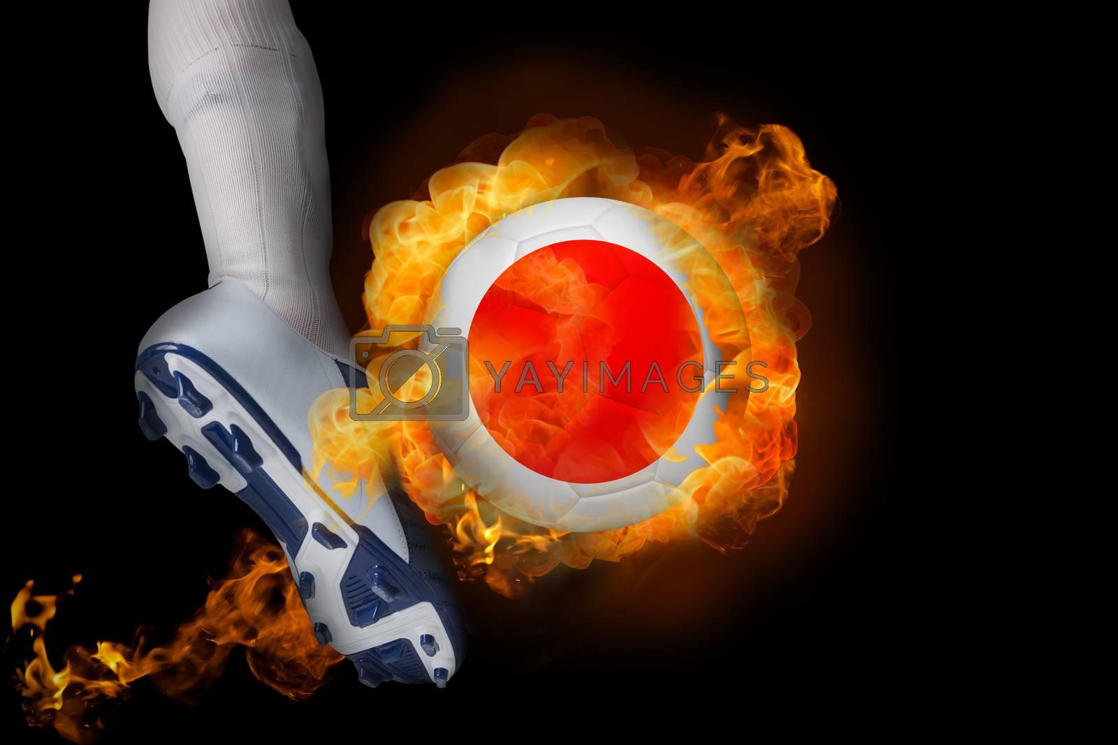 Football player kicking flaming japan ball by Wavebreakmedia