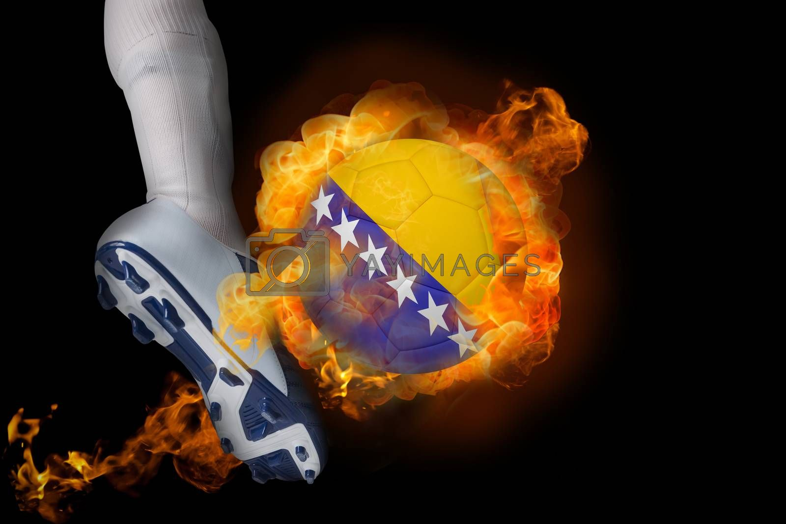 Football player kicking flaming bosnia ball by Wavebreakmedia