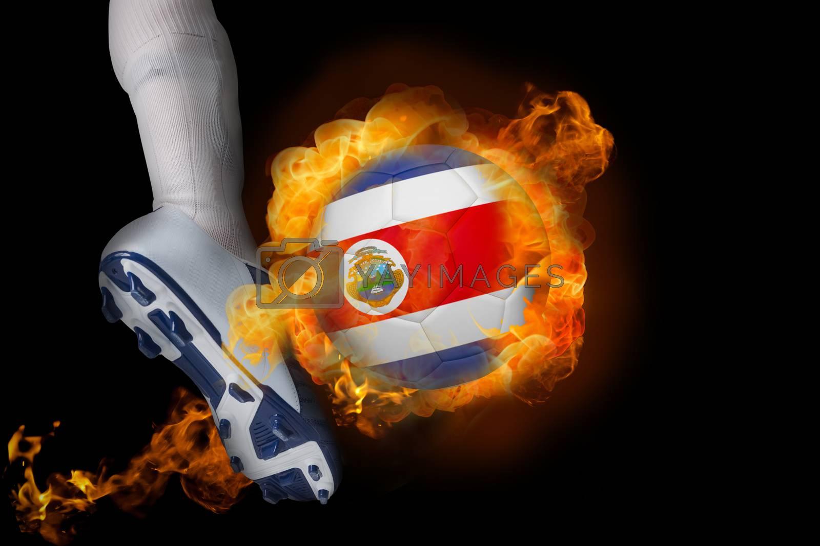 Football player kicking flaming costa rica ball by Wavebreakmedia