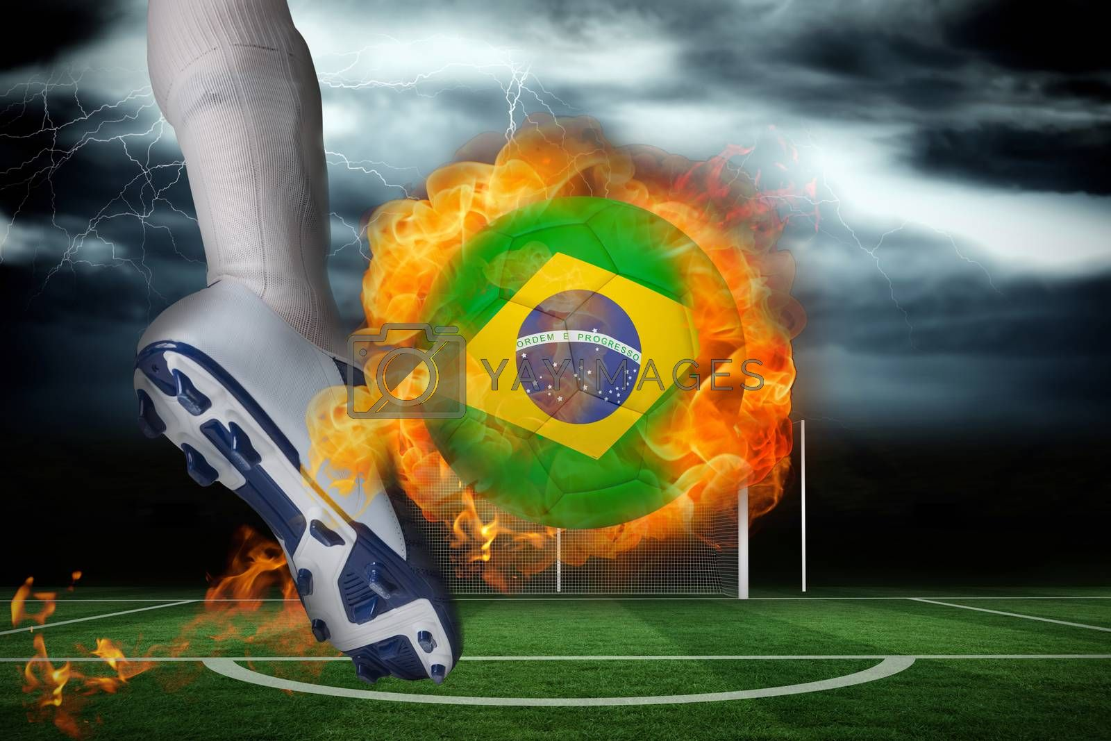 Football player kicking flaming brasil flag ball by Wavebreakmedia