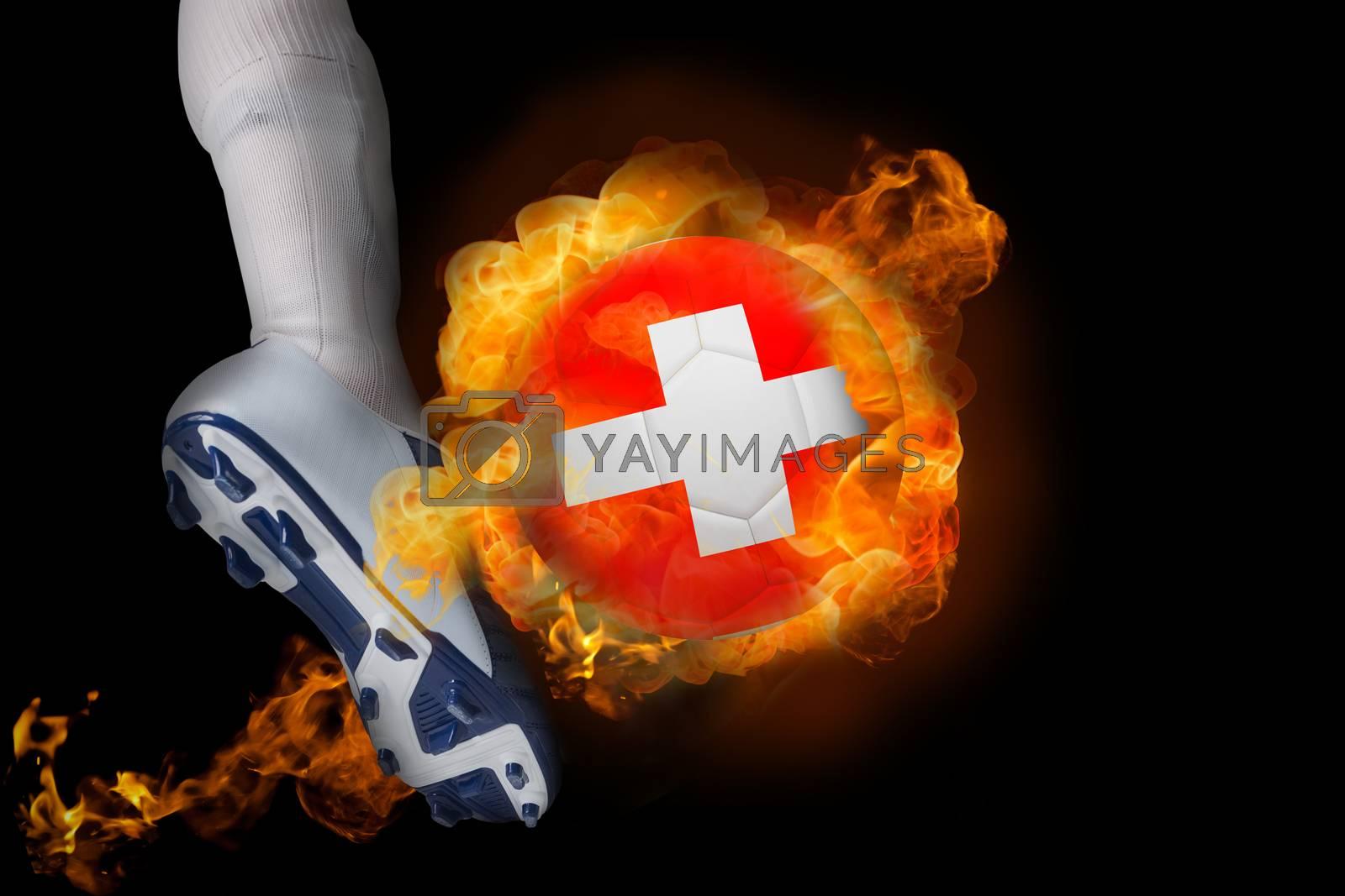 Football player kicking flaming switzerland ball by Wavebreakmedia
