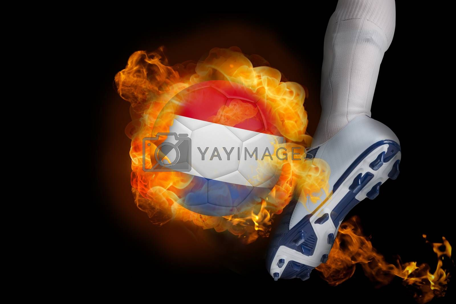 Football player kicking flaming netherlands ball by Wavebreakmedia