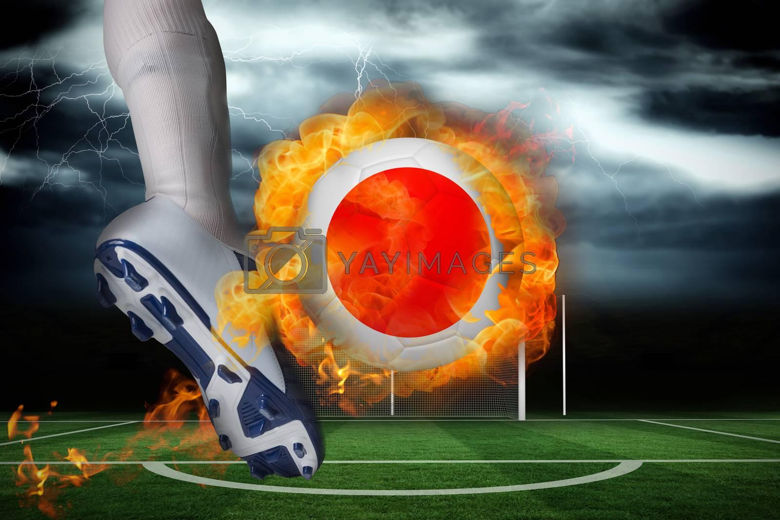 Football player kicking flaming japan flag ball by Wavebreakmedia