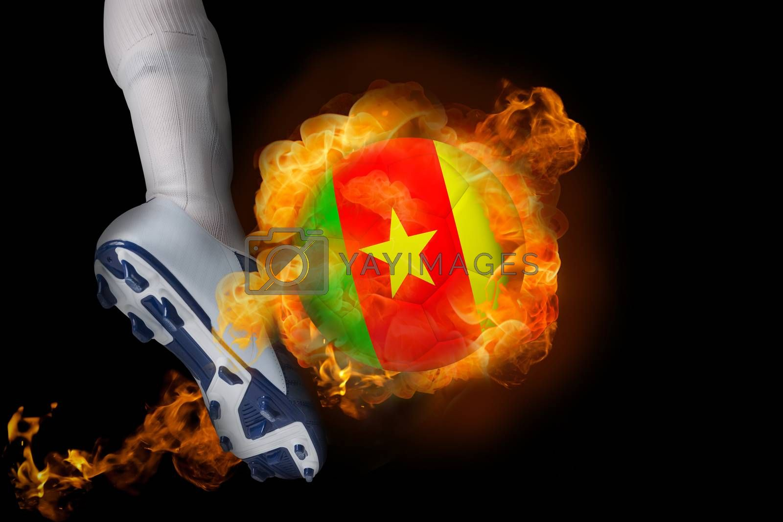 Football player kicking flaming cameroon ball by Wavebreakmedia