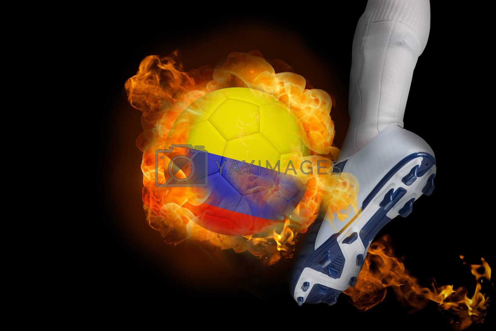 Football player kicking flaming colombia ball by Wavebreakmedia