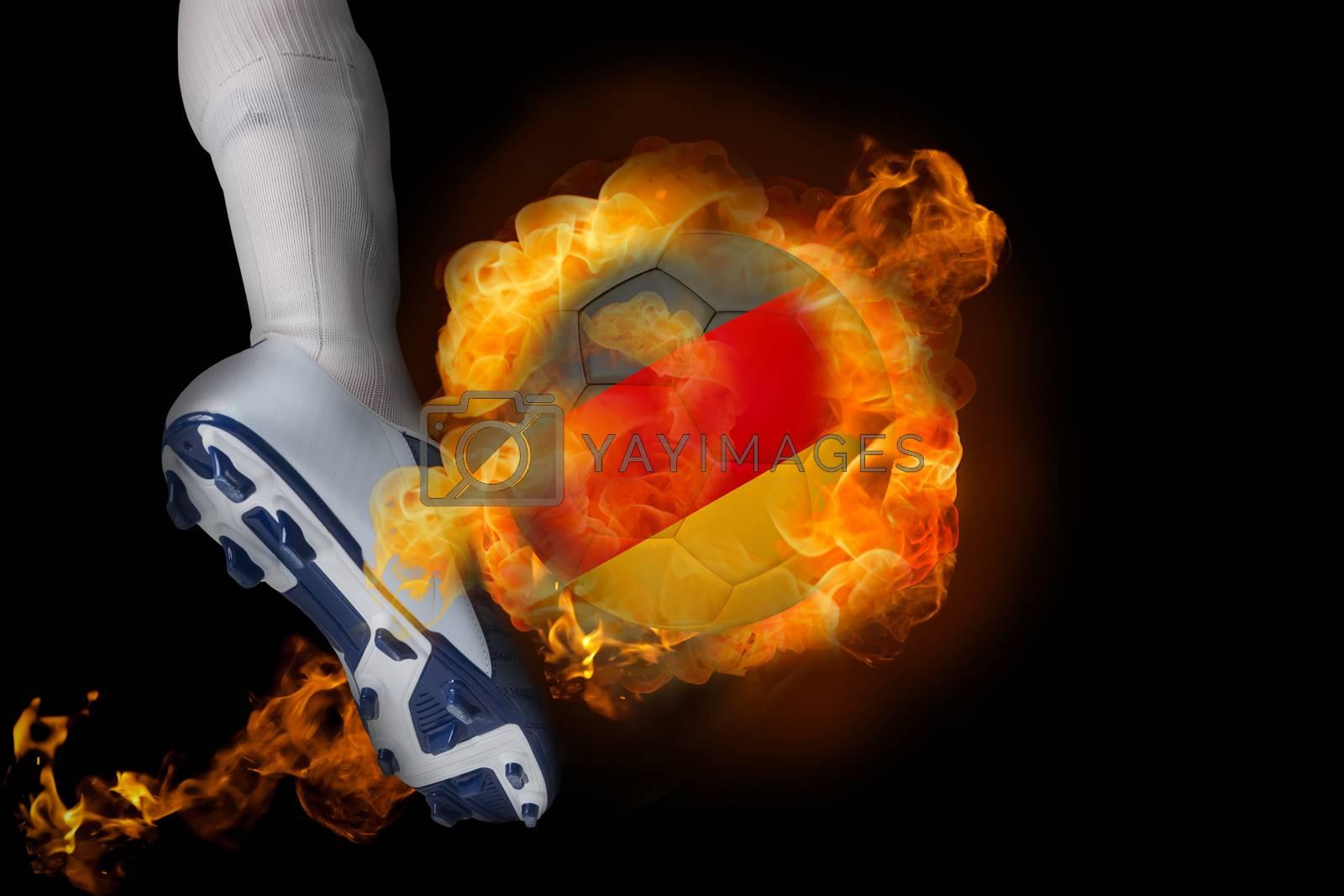 Football player kicking flaming germany ball by Wavebreakmedia