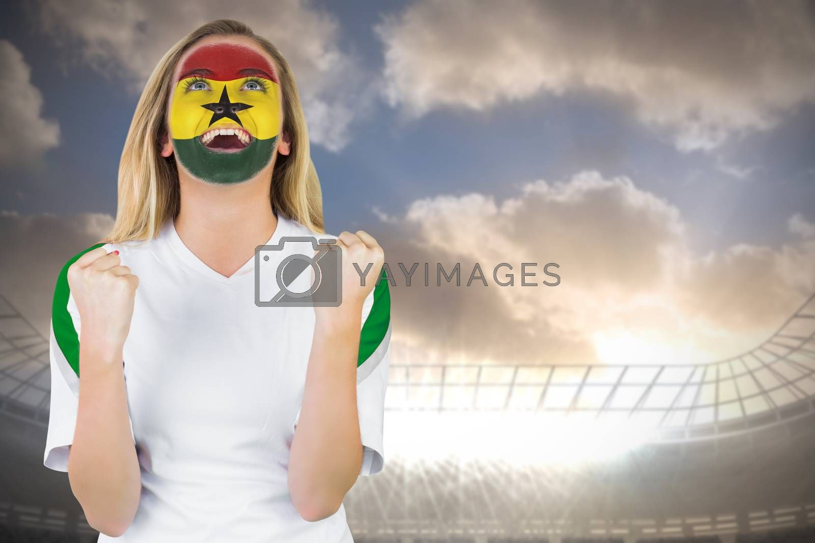Excited ghana fan in face paint cheering by Wavebreakmedia