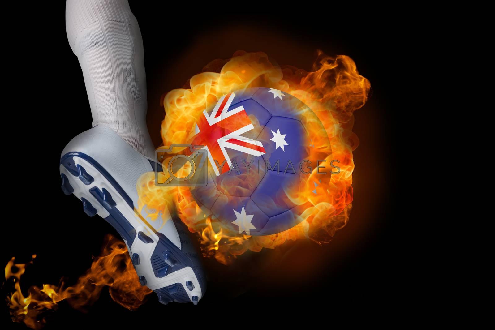 Football player kicking flaming australia ball by Wavebreakmedia