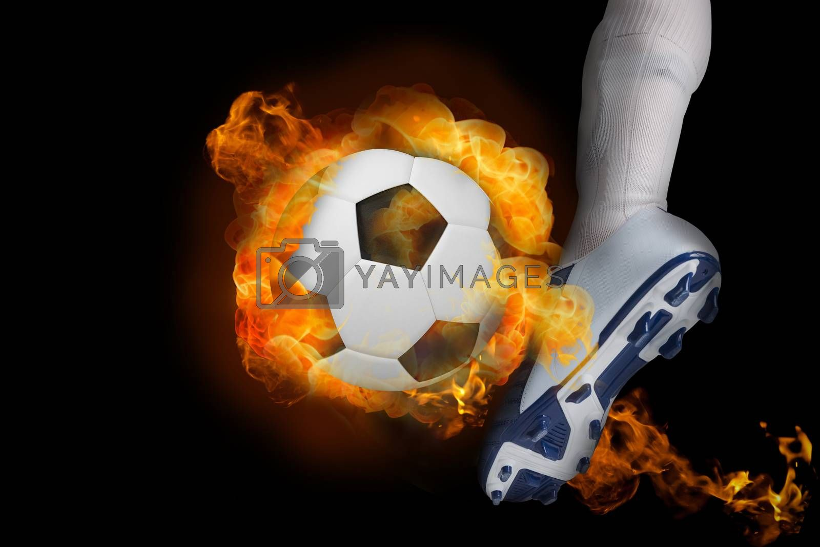 Football player kicking flaming ball by Wavebreakmedia