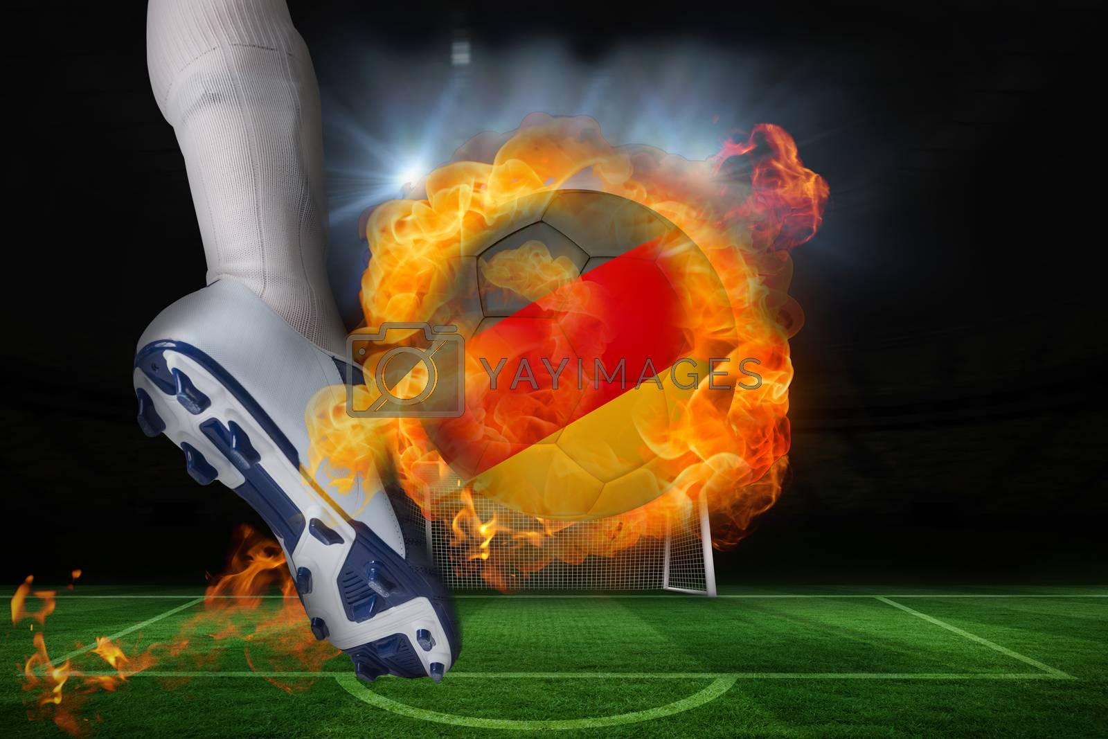 Football player kicking flaming germany flag ball by Wavebreakmedia