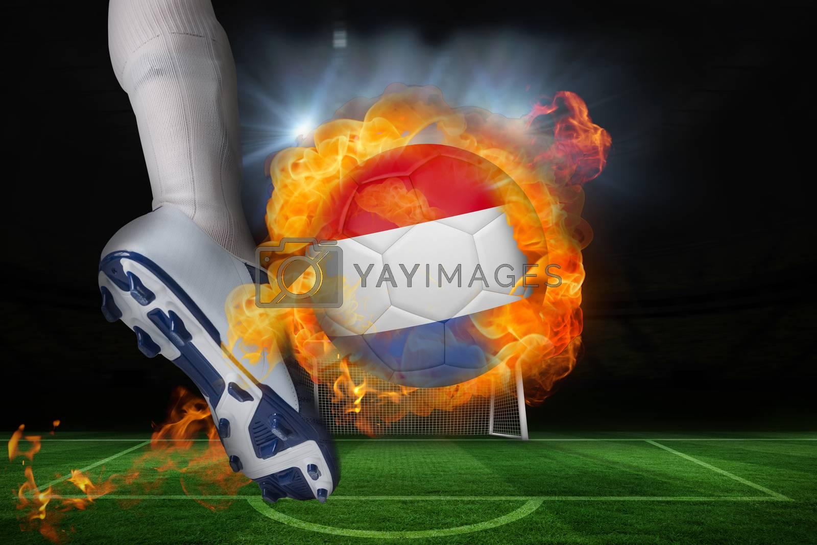 Football player kicking flaming netherlands flag ball by Wavebreakmedia