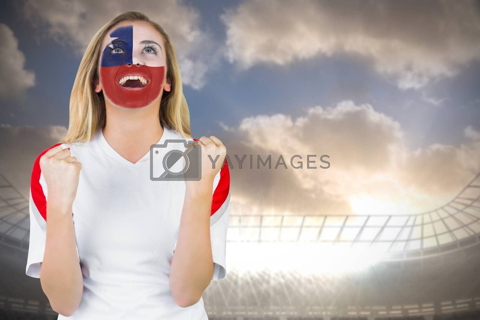 Excited chile fan in face paint cheering by Wavebreakmedia